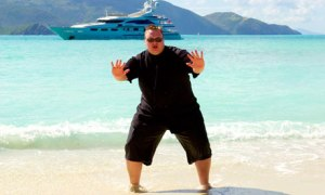 Kim Dotcom posing before one of his yachts. (Courtesy: thedrum.com)